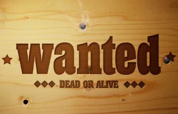Smokin Bullet Holes and a Wanted Sign 30+ Photoshop text effect tutorials